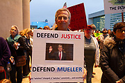 """John Gauthier from Richland Hills Texas holds a sign in front of Dallas City Hall in downtown Dallas. The protest part of the """"Red Line"""" protest nationwide series was prompted by trump's crossing of a red line, interfering in any way with Special Counsel Robert Mueller's investigation into the President's administration. Trump fired Attorney General Jeff Sessions and replaced him with Matthew Whitaker, a GOP loyalist, and removed Deputy Rod Rosenstein's oversight of the the Mueller investigation. This is Gauthier's first protest in his life."""