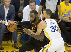 May 31, 2018 - Oakland, California, U.S - LeBron James #23 of the Cleveland  Cavaliers looks to drive  against Stephen Curry #30 of the Golden State Warriors  during their NBA Championship Game 1 at Oracle Arena in  Oakland, California on Thursday,  May 31, 2018. ARMANDO  ARORIZO/PI (Credit Image: © Prensa Internacional via ZUMA Wire)