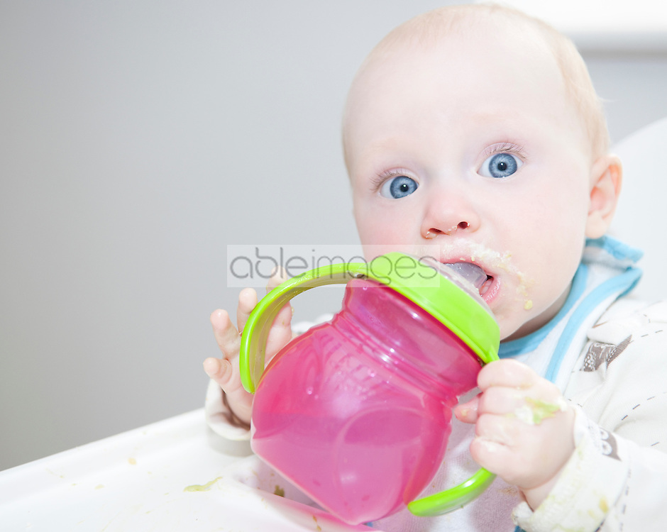 Wide Eyed Baby Drinking