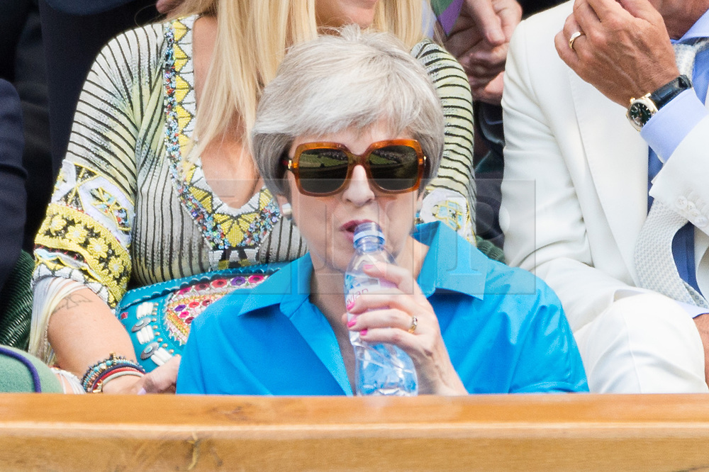 © Licensed to London News Pictures. 15/07/2018. London, UK. British Prime Minister Theresa May watches centre court tennis in the royal box on the 13th day of the Wimbledon Tennis Championships 2018 held at the All England Lawn Tennis and Croquet Club. Photo credit: Ray Tang/LNP