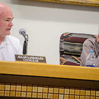 City coucilor Allan Landavazo, left, and mayor Jackie McKinney discuss recycling collection during the city council meeting at Gallup City Hall Tuesday.
