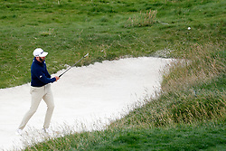 June 12, 2019 - Pebble Beach, CA, U.S. - PEBBLE BEACH, CA - JUNE 12: PGA golfer Dustin Johnson hits out of a sand trap on the 17th hole during a practice round for the 2019 US Open on June 12, 2019, at Pebble Beach Golf Links in Pebble Beach, CA. (Photo by Brian Spurlock/Icon Sportswire) (Credit Image: © Brian Spurlock/Icon SMI via ZUMA Press)