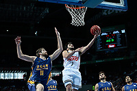 SPAIN, Madrid: Real Madrid's Argentine player Facundo Campazzo and Ucam Murcia´s Montenegrin player Nemanja Radovic during the Liga Endesa Basket 2014/15 match between Real Madrid and Ucam Murcia, at Palacio de los Deportes in Madrid on November 16, 2014.