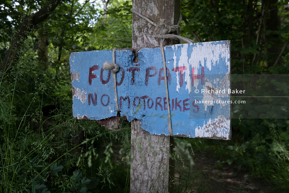 A detail of a warning sign for the users of a public footpath, that private land is ahead, forbidding the use of motorbikes, on 13th June 2021, in Kemsing, Kent, England.