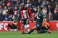 Football - 2019 / 2020 Premier League - Southampton vs. Newcastle United<br /> <br /> Southampton's Moussa Djenepo fouls Isaac Hayden of Newcastle to get a red card for serious foul play after a VAR decision carried out by Referee Mr Graham Scott on the pitch side monitor at St Mary's Stadium Southampton<br /> <br /> COLORSPORT/SHAUN BOGGUST