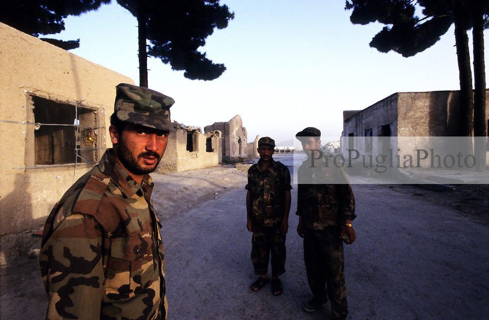 Kabul, 17 July 2005..ANA soldiers patrolling the decadent buildings in a diserted district of the capital