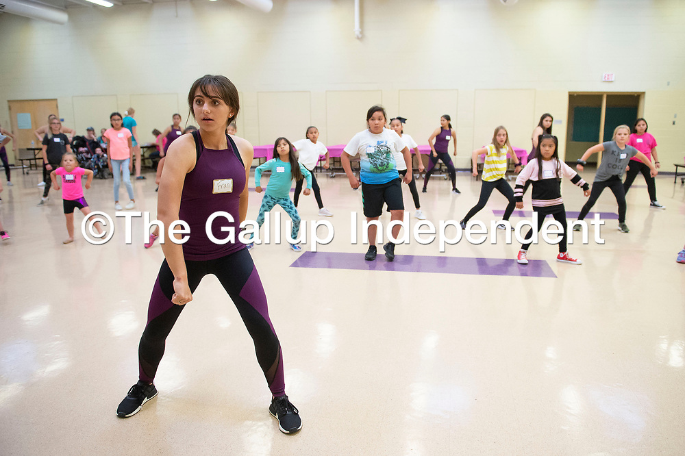 Francesca Chioda leads more than 20 girls at the Miyamura Patriette Dance Clinic Thursday evening in Gallup in its sixth year. The routine learned at the dance clinic hosted by the Miyamura Patriette dance team will be performed during halftime at Miyamura's home football game Friday evening.