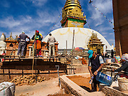 04 MARCH 2017 - KATHMANDU, NEPAL: Construction workers rebuild one of the shrines at Swayambhu Stupa. The stupa was badly damaged in the 2015 Nepal earthquake. Recovery seems to have barely begun nearly two years after the earthquake of 25 April 2015 that devastated Nepal. In some villages in the Kathmandu valley workers are working by hand to remove ruble and dig out destroyed buildings. About 9,000 people were killed and another 22,000 injured by the earthquake. The epicenter of the earthquake was east of the Gorka district.     PHOTO BY JACK KURTZ