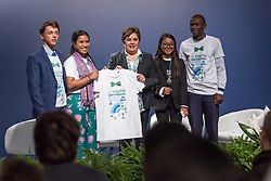 5 December 2019, Madrid, Spain: Youth give a t-shirt to UNFCCC Executive Secretary Patricia Espinosa after a youth briefing at COP25 in Madrid.