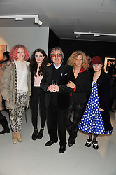 Left to right, JESSICA WYMAN, MATILDA WYMAN, BILL WYMAN, SUZANNE WYMAN and KATHERINE WYMAN at a private view of Bill Wyman - Reworked held at the Rook & Raven Gallery, 7 Rathbone Place, London W1 on 26th February 2013.