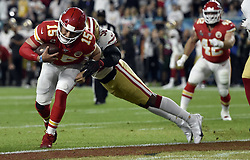 February 2, 2020, Miami Gardens, FL, USA: Kansas City Chiefs quarterback Patrick Mahomes (15) sheds the tackle of San Francisco 49ers center Weston Richburg (58) to score a touchdown in the first quarter of Super Bowl 54 on Feb. 2, 2020 at Hard Rock Stadium, in Miami Gardens, FL. (Credit Image: © TNS via ZUMA Wire)