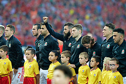 LILLE, FRANCE - Friday, July 1, 2016: Wales' Joe Ledley gives a thumbs up as the team line up ahead of the the UEFA Euro 2016 Championship Quarter-Final match against Belgium at the Stade Pierre Mauroy. Gareth Bale, Hal Robson-Kanu, Ben Davies, Joe Allen, James Chester, Neil Taylor. (Pic by Paul Greenwood/Propaganda)