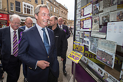 © Licensed to London News Pictures . 05/06/2014 . Newark , Nottinghamshire , UK . UKIP leader NIGEL FARAGE enters the UKIP shop in Newark today (Thursday 5th June 2014) as voting takes place in the Newark by-election , following the resignation of incumbent Patrick Mercer . Photo credit : Joel Goodman/LNP