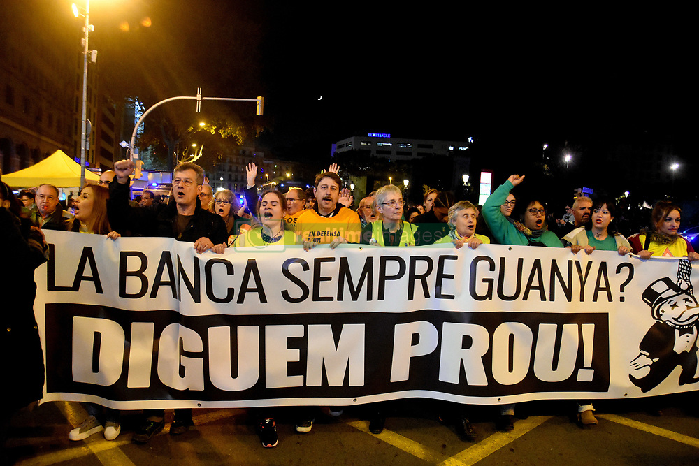 November 10, 2018 - Barcelona, Barcelona, Spain - Protesters seen holding a huge banner saying, Banking always wins, enough is enough during the protests..Hundreds of people from all parts of Spain protest against the Spanish Supreme Court decision of clients and not the banks to pay the tax on mortgages. (Credit Image: © Ramon Costa/SOPA Images via ZUMA Wire)