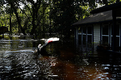Water comes up to roofs of homes near Black Creek in Middleburg, FL, on September 12, 2017 after water levels rose from Hurricane Irma. The storm system took an unexpected turn and caused massive power outages and coastal flooding around the state.