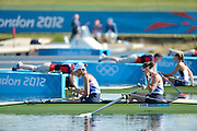 Eton Dorney, Windsor, Great Britain,..2012 London Olympic Regatta, Dorney Lake. Eton Rowing Centre, Berkshire[ Rowing]...Description;  GBR W2-, Bow Helen GLOVER, cooling herself with some Lake water, and Heather STANNING, at the start pontoon, for their heat of the Women's Pair .  Dorney Lake. 11:27:39  Saturday  28/07/2012. [Mandatory Credit: Peter Spurrier/Intersport Images]. July/Aug
