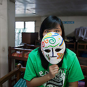 Arianna, 16. (Not her real name). She loves being in the Laura Vicuna home because of the protection the sisters give her because she was at risk of being abused in the streets. She loves reading fairy tales and wants to become a doctor to help others in need. When she was making the mask she was thinking of herself and how she was feeling...Arianna lived for 10 years with her sister Anne and father in the streets in Bacood district of Manila. The two sisters lived in a small cart and their father slept on the floor underneath. He had left his wife and was taking of the kids by collecting and selling junk, - plastic, metal and wood. The girls did not start school till Anne was 8 and they had to share flip-flops and books, going to school in turn. The girls were taken in by the Laura Vicuna sisters after a teacher raised concerns about the girls being abused in the streets.