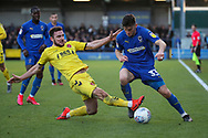 Fleetwood Town defender Lewis Coyle (2) battles for possession with AFC Wimbledon midfielder Callum Reilly (33) during the EFL Sky Bet League 1 match between AFC Wimbledon and Fleetwood Town at the Cherry Red Records Stadium, Kingston, England on 8 February 2020.
