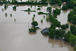 May 22, 2019 - Tulsa, OK, United States of America - Aerial view of flooding over the banks of the Arkansas River May 22, 2019 in Tulsa, Oklahoma. More than 1000 homes have been effected by the floods brought by extreme rain accompanied by tornados. (Credit Image: © Rebecca Imwalle via ZUMA Wire)