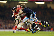 Luke Charteris of Wales is tackled by Jonny Gray of Scotland.RBS Six nations championship 2016, Wales v Scotland at the Principality Stadium in Cardiff, South Wales on Saturday 13th February 2016. <br /> pic by  Andrew Orchard, Andrew Orchard sports photography.
