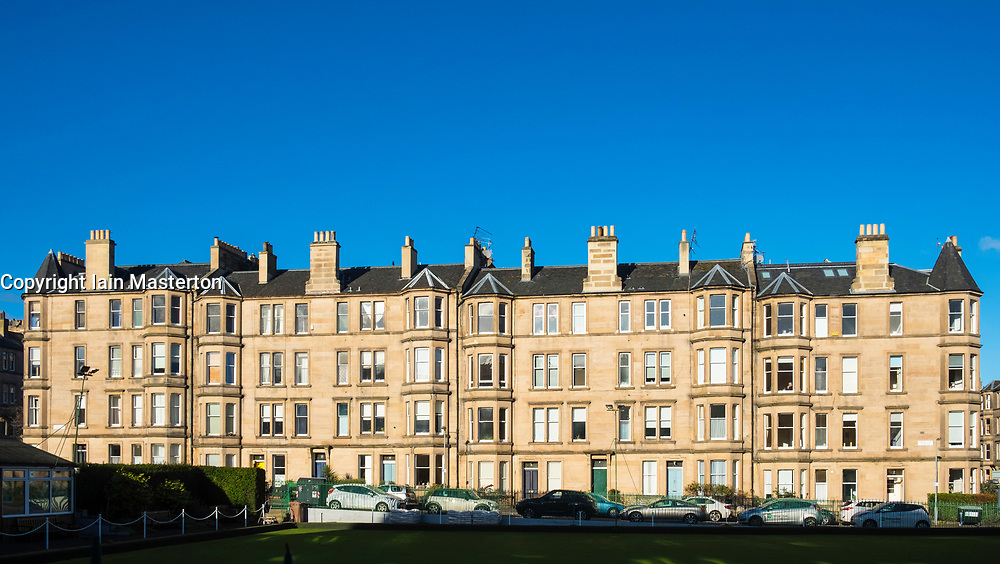 View of row of sandstone terraced apartments (tenements) on Comely Bank Terrace in Edinburgh, Scotland, United Kingdom