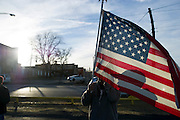 Tony Murphy carries an American flag during an open carry long rifle march demonstrating his 2nd amendment right to keep and bear arms on Thursday, January 31, 2013 in Fort Worth, Texas. (Cooper Neill/The Dallas Morning News)