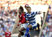 Photo: Chris Ratcliffe.<br />Reading v Manchester United. The Barclays Premiership. 23/09/2006.<br />Kevin Doyle of Reading clashes with Gabriel Heinze (L) of Man Utd.