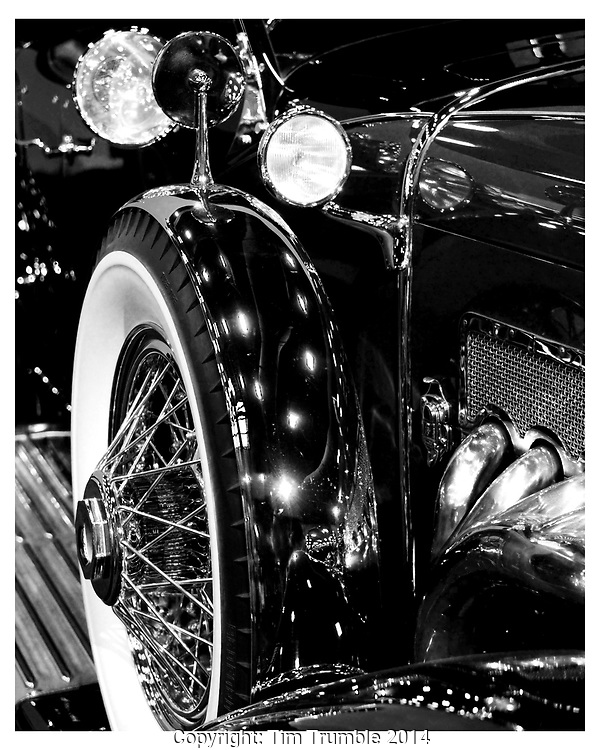 Black and white image of Duesenberg spare tire detail.