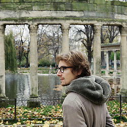 PARIS, FRANCE. NOVEMBER 22, 2010. French actor and writer Lorant Deutsch at the Parc Monceau, close to his home in the 17th arrondissement. Behind stand corinthian columns build as ruins for the Duc de Chartres' naumachia. (photo: Antoine Doyen)