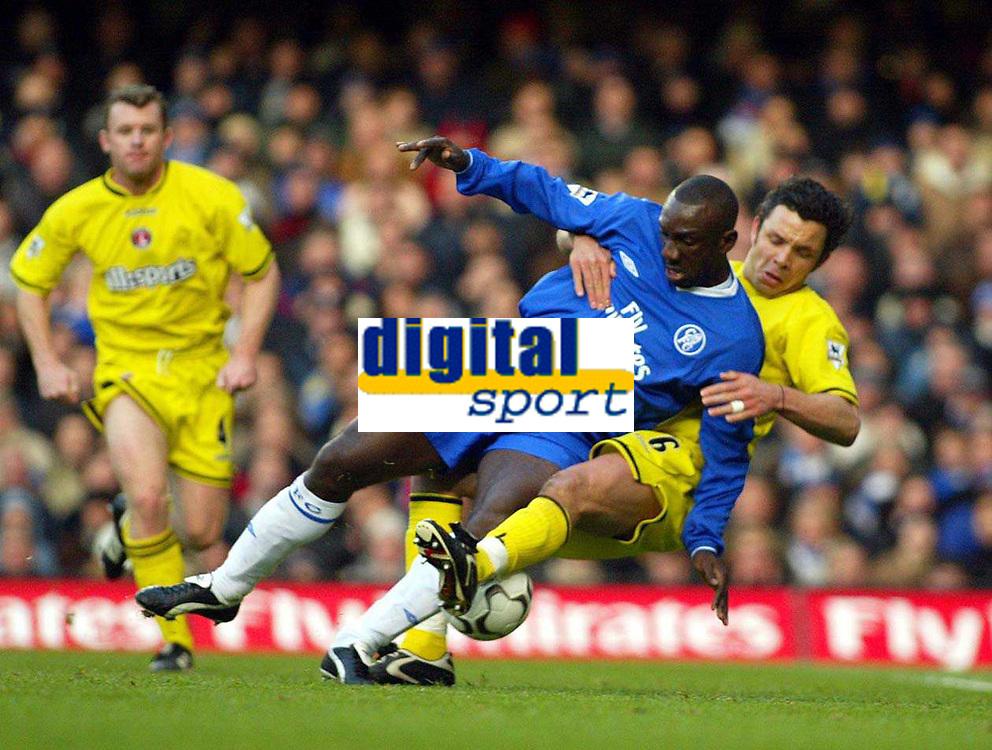 Photo: Scott Heavey.<br /> Chelsea v Charlton Athletic. FA Barclaycard Premiership. 08/02/2004.<br /> Mark Fish (R) pulls Jimmy Floyd Hasselbaink down to earn Chelsea a penalty