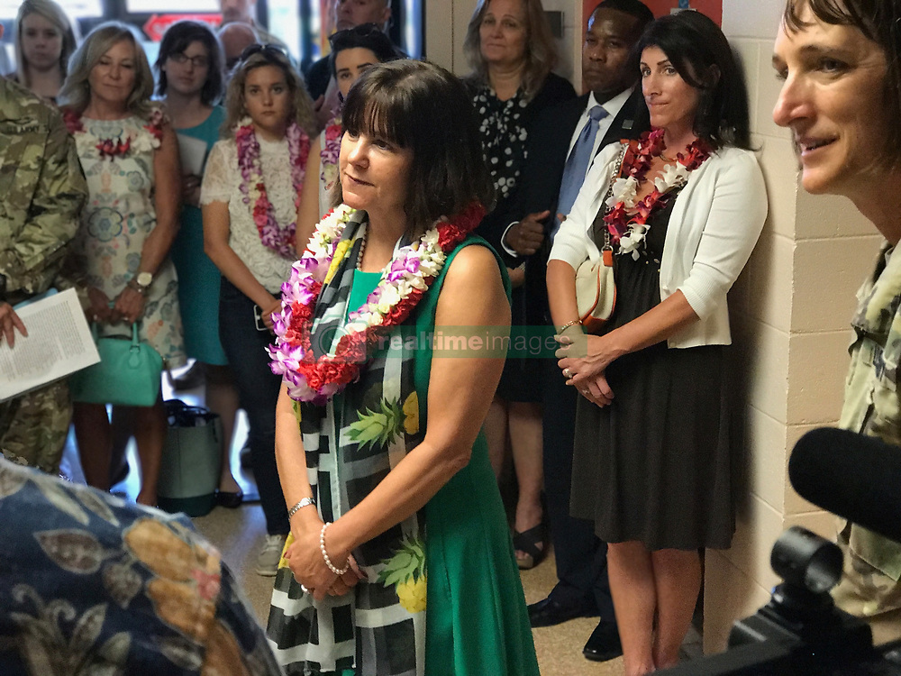 April 24, 2017 - Honolulu, HI, United States of America - Karen Pence, wife of U.S. Vice President Mike Pence  listens to military family members during a tour of the Health Clinic at Schofield Barracks April 24, 2017 in Honolulu, Hawaii. The visit was to to talk about how a form of alternative therapy is being used to help military members and their families deal with difficulties, disabilities or diagnoses. (Credit Image: © Amy Parr/Planet Pix via ZUMA Wire)