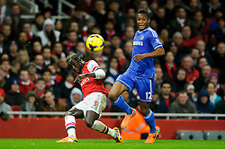 Arsenal Defender Bacary Sagna (FRA) crosses past Chelsea Midfielder Mikel John Obi (NGA) during the first half of the match - Photo mandatory by-line: Rogan Thomson/JMP - Tel: Mobile: 07966 386802 - 23/12/2013 - SPORT - FOOTBALL - Emirates Stadium - Arsenal v Chelsea - Barclays Premier League.