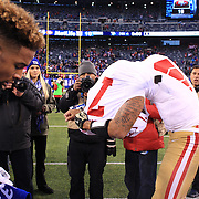 Odell Beckham Jr and Colin Kaepernick swap signed shirts  after the New York Giants V San Francisco 49ers, NFL American Football match at MetLife Stadium, East Rutherford, NJ, USA. 16th November 2014. Photo Tim Clayton