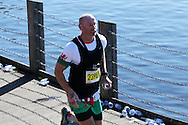 ex Wales rugby international Gareth Thomas running. Action from the Cardiff Half Marathon 2016 in Cardiff, South Wales on Sunday 2nd October 2016. this years event had a record of almost 22,000 entries, a mixture of fun runners, elite athletes and club runners.<br /> pic by Andrew Orchard, Andrew Orchard sports photography.