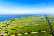 Nederland, Noord-Holland, Gemeente Edam-Volendam, 13-06-2017; Polder Zeevang met Zeevangse Zeedijk, IJsselmeerdijk ten noorden van Edam bij Warder. Edam aan de horizon.<br /> De dijk staat op de nominatie om verstrekt te worden, bewoners en actievoerders vrezen aantasting van de monumentale dijk en verlies culturele waarden.<br /> Zeevangse Zeedijk (seawall) north of Edam.<br /> The dike is nominated to be reinforced, residents and activists fear losing the monumental quality of the dike and losing other cultural values.<br /> <br /> luchtfoto (toeslag op standaard tarieven);<br /> aerial photo (additional fee required);<br /> copyright foto/photo Siebe Swart