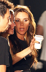 Cup of coffee in hand Victoria Beckham  talks to her staff before the start of her New York Fashion Week for Spring/ Summer 2013 , Sunday 9th September 2012. Photo by: Stephen Lock / i-Images