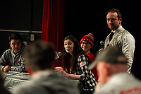 The SPELLtacular Team of Josh Chandler, Nathan Papavlo, Colleen O'Brien and Faith Pakasuk with MC Tate Aldrich look to the judges to see if they will advance to the next round during LHS Spelling Bee on Thursday evening.  (Karen Bobotas/for the Laconia Daily Sun)