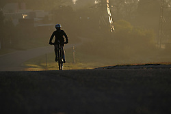 JOHANNESBURG, SOUTH AFRICA - MAY 10: A cyclist out exercising in Randburg during lockdown level 4 on May 10, 2020 in Johannesburg, South Africa. According to media reports, during lockdown level 4 people are allowed to exercise. Guidelines allow for cycling, running and walking as examples and must be within a 5km radius of their residences between 6:00 am – 9:00 am. (Photo by Dino Lloyd)