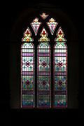 Geometric pattern design stained glass east window parish church of Saint Mary, Battisford , Suffolk, England c 1902