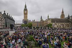 © Licensed to London News Pictures. 21/08/2017. London, UK. People gather at midday in Parliament Square as Big Ben chimes for the last time before repairs start. The Great Bell, also known as Big Ben, is expected to be silent for up to four years as renovation work is carried out on Elizabeth Clock Tower. The worlds most famous clock has sounded on the hour for 157 years and last fell silent for maintenance work in 2007. Photo credit: Peter Macdiarmid/LNP