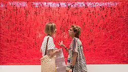 """© Licensed to London News Pictures. 28/06/2018. LONDON, UK. Visitors share a conversation in front of """"State of Being"""", 2016, by Chiharu Shiota. Members of the public visit Masterpiece London, the world's leading cross-collecting art fair held in the grounds of the Royal Hospital Chelsea.  The fair brings together 160 international exhibitors presenting works from antiquity to the present day and runs 28 June to 4 July 2018.  Photo credit: Stephen Chung/LNP"""