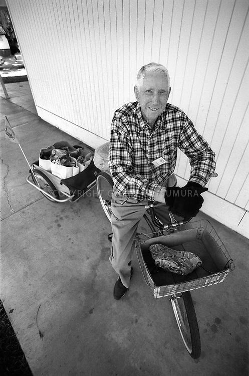 Senior volunteer delivering groceries on his bike for Second Harvest Food Bank