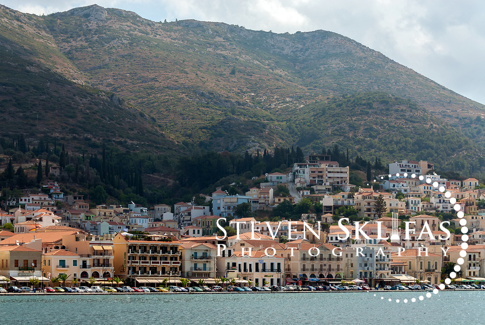 Samos. Greece. Waterfront adorned with neo-classical buildings of Vathy or Samos town which rises into wooded hills above. Vathy or Samos town is situated on a horseshoe shaped bay and is the capital and largest town of Samos.