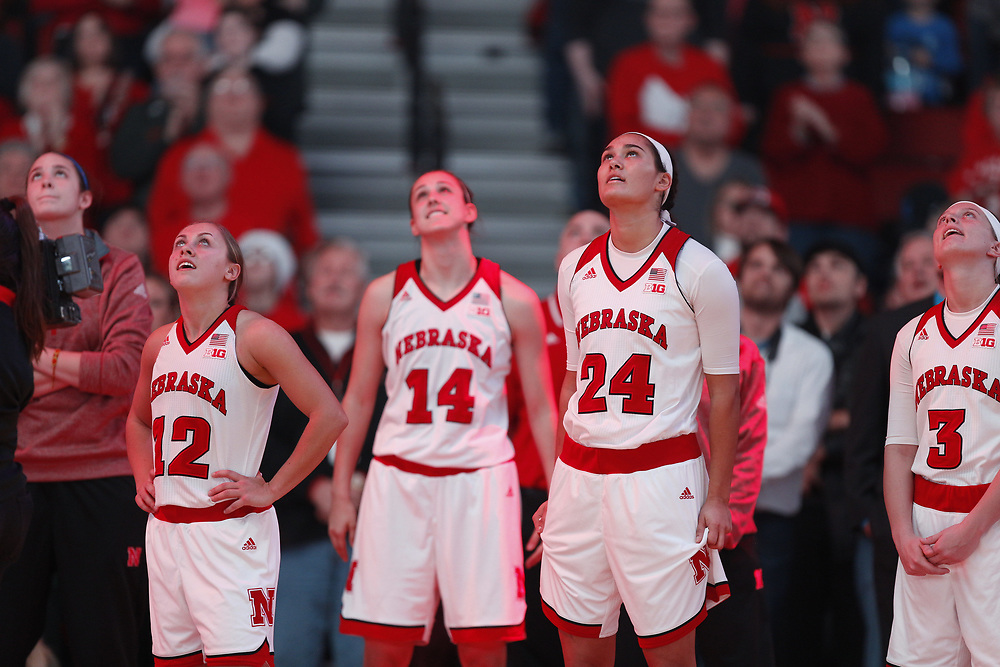 Nebraska Cornhuskers Emily Wood #12, Grace Mitchell #14, Maddie Simon #24 and Hannah Whitish #3 watch the video board during introductions prior to Nebraska's 84-41 loss to No. 1-ranked UConn at Pinnacle Bank Arena in Lincoln, Neb. on Dec. 21, 2016. Photo by Aaron Babcock, Hail Varsity