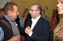 Left to right, NICKY HASLAM and PAUL McKENNA at a party to celebrate the publication of 'You Are Here' by Rory Bremner, Juhn Bird and John Fortune held at the National Portrait Gallery, St.Martin's Place, London on 1st November 2004.<br /><br />NON EXCLUSIVE - WORLD RIGHTS