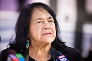 """07 DECEMBER 2010 - PHOENIX, AZ:  DOLORES HUERTA speaks out on behalf of the DREAM Act in the front of the offices of US Sen. John McCain in Phoenix Tuesday.  Huerta, who started working in the civil rights movement in the 1960's, threw her support behind students fasting on behalf of the DREAM Act in front of Sen. John McCain's office Tuesday. The student picked McCain's office because he used to support the DREAM Act. They hope that the US Senate will pass the DREAM Act during its """"lame duck"""" session. The Senate debated and defeated similar legislation just before the November general election.   PHOTO BY JACK KURTZ"""