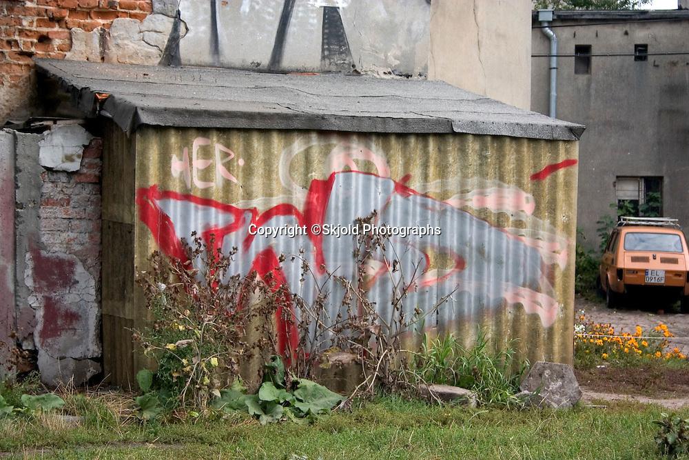 Graffiti on tin storage building near the Balucki Rynek Market.   Lodz   Central Poland
