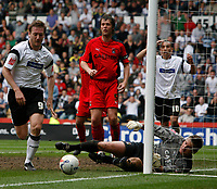 Photo: Steve Bond.<br />Derby County v Coventry City. Coca Cola Championship. 09/04/2007. Andy Marshall saves at the near post as Steve Howard (L) closes in