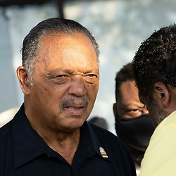 Rev.  JESSE JACKSON , l, speaks with WILLIAM BARBER as voting rights groups march toward the Texas Capitol from north Austin on the third day of a 30-mile journey protesting Republican efforts to suppress votes nationwide and in Texas. Shifts of marchers trade off in an effort to combat oppressive Texas heat.