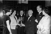 16/01/1963<br /> 01/16/1963<br /> 16 January 1963<br /> Limerickmens Association Annual Dinner at the Clarence Hotel, Dublin. Picture shows: Mr T.L. O'Halloran, Chairman of the Association presenting a Cup on behalf of the Association to Miss Chris O'Connell, Chairman of Limerick County Camogie Board and President of the Central Council Camogie Board to be competed for by Cp. Limerick Secondary Schools. Included (l-r): Miss Joan O'Shea, Treasurer; Rev. Fr. E. Neville, President; Mr Pat Mac Namee, Vice-President and Miss Mary Lynch, Secretary.